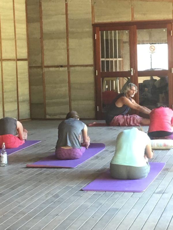 yoga class with teacher and students
